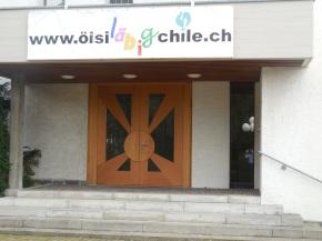 De Iigang von de reformierte Chile mit em Fäschtlogo
