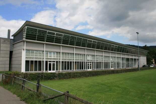 http://commons.wikimedia.org/wiki/Category:Buildings_in_Wettingen#mediaviewer/File:Wettingen_Sporthalle_Taegi_8408.jpg